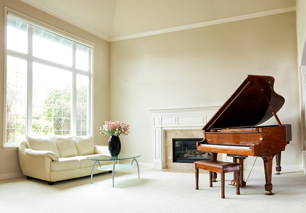living room furniture with a piano.