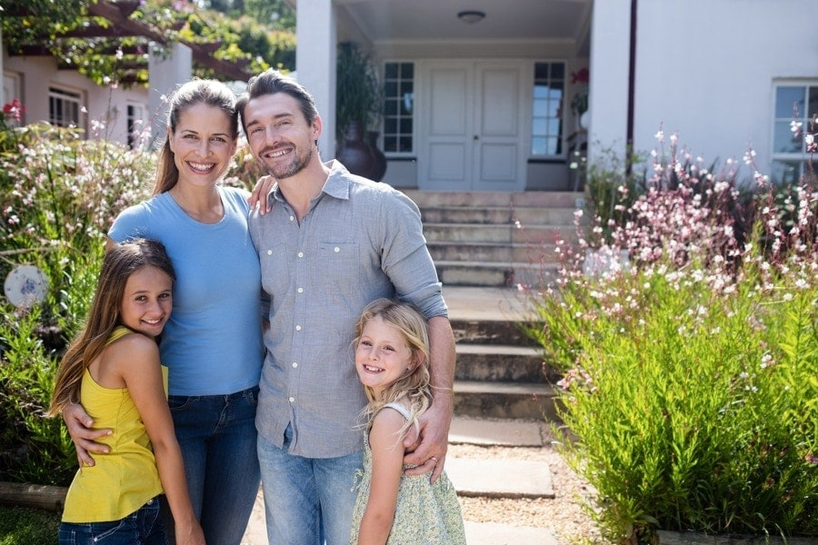 Family standing outside their Austin house.