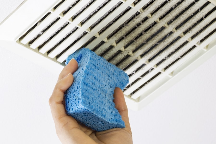 dusting a vent.
