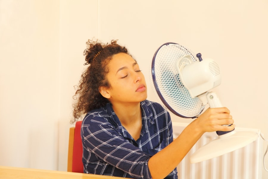 person cooling down because of a broken AC